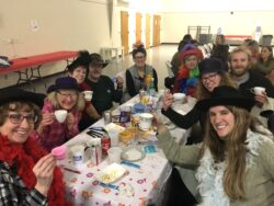Table of 9 people wearing crazy hats